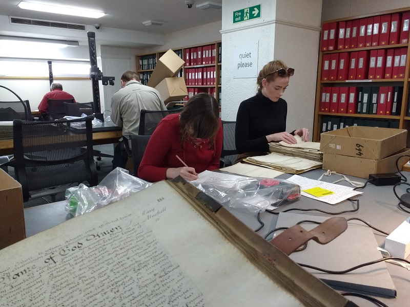Team Macintosh hard at work in the archive.